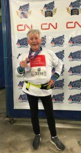 John Buchanan, with his 30K run medal
