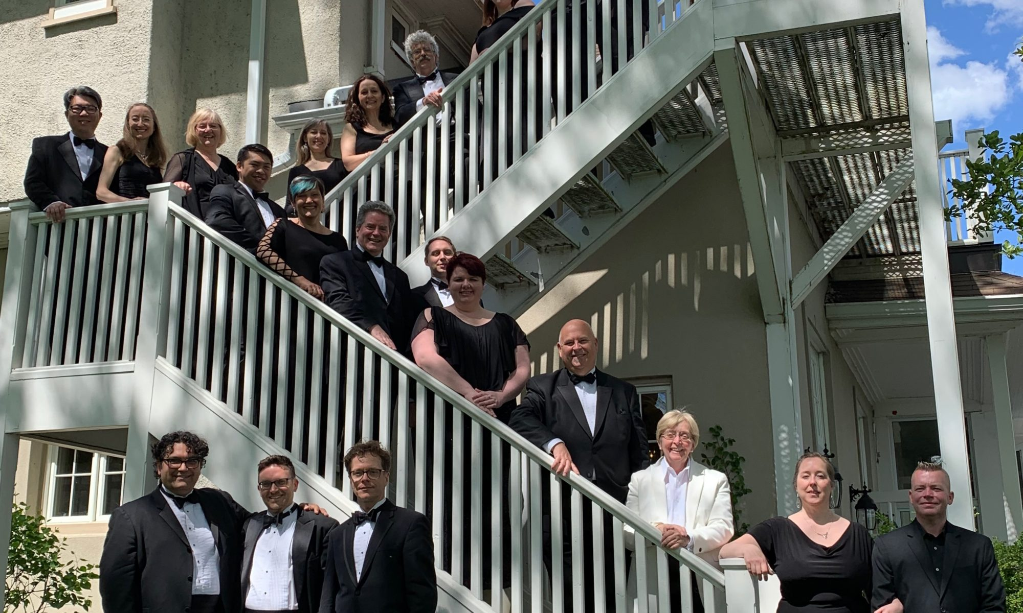 Elmer Iseler Singers along a staircase at the Toronto Hunt Club